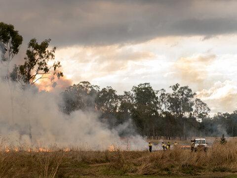 Firefighters attending a grass fire