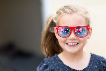 Young girl wearing Australian Flag sunglasses for Australia Day
