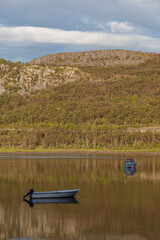 Boats on an anchor in the scenic delta of river in Ifjord in Finnmark, Norway