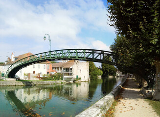 metal footbridge, built according to the Gustave Eiffel process, above the Briare canal, in Montargis, in the center-val-de-Loire region in the heart of France