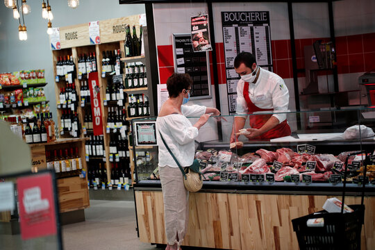 A customer shops at the butcher section of a Naturalia organic foods grocery store operated by Casino Group, in Bretigny-sur-Orge