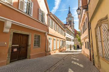 Historic buildings and church tower in a picturesque street in the old town of Tübingen in Southern Germany