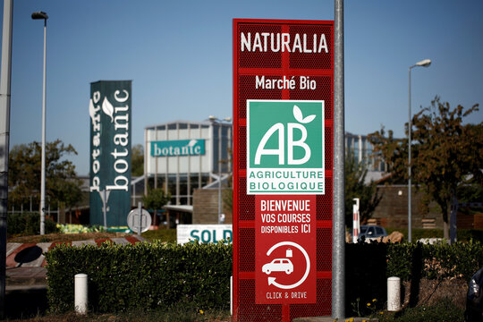 Naturalia's logo hangs on a sign outside of the organic foods grocery store, operated by Casino Group, in Bretigny-sur-Orge