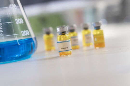 A blue and yellow chemical liquids into test tubes in clean laboratory room.