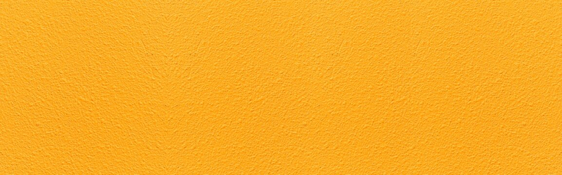 Panorama of Patterned cement wall Vintage yellow painted texture and background