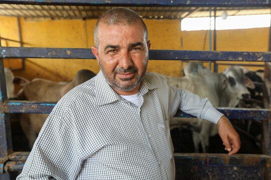 Hatem Abulashra, a livestock merchant, is pictured in his livestock farm in Tripoli