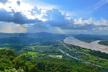 Scenery of Amazing Sky above Mekong river, Mountain and Thai Countryside Nong Khai province,...