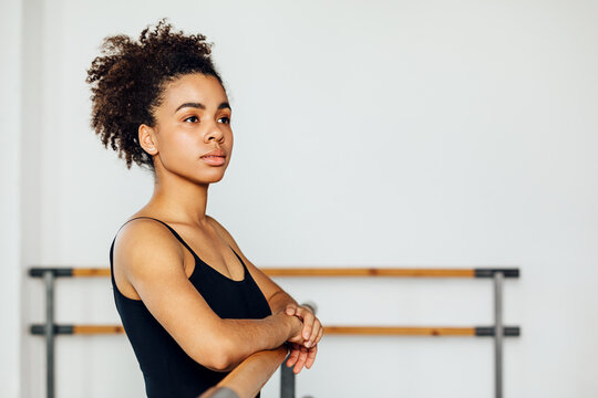 Portrait of a professional ballet dancer looking away while standing in a studio
