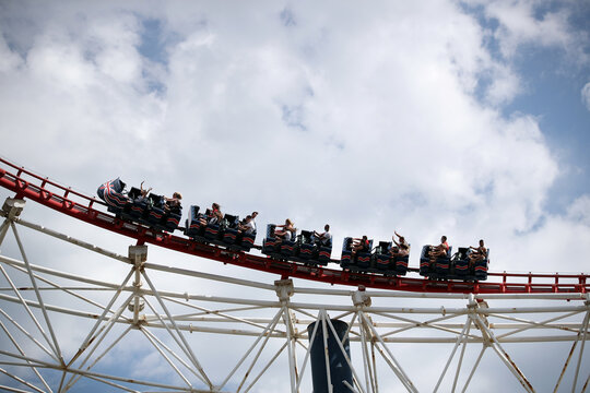 People are pictured on a rollercoaster at Blackpool Pleasure Beach, in Blackpool