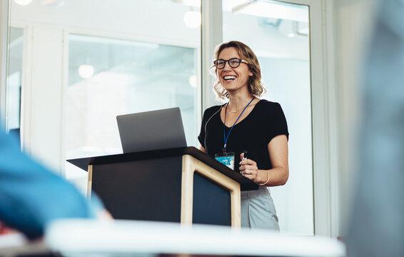 Female business professional addressing a seminar