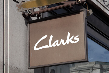 London, UK, February 27, 2011 : Clarks logo advertising sign outside one of its shoe stores in the city centre stock photo