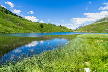 Small alpine lake at Maddalena Pass (Colle della Maddalena) located on the border between Italy and France