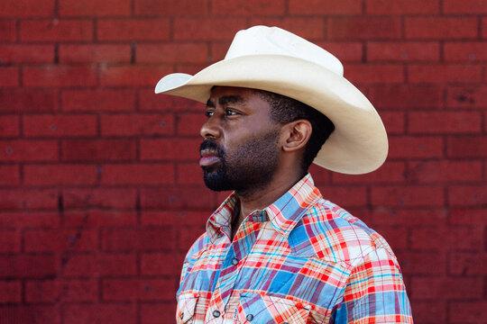 Portrait of millennial generation farmer and cowboy