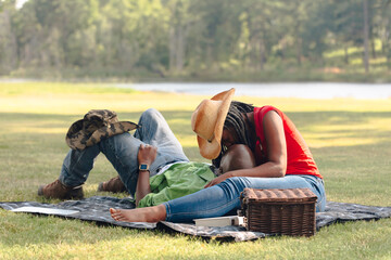Middle aged couple having picnic in park