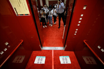 Foot marks to indicate visitors to keep social distancing are seen inside an elevator at the Kabukiza Theatre amid the coronavirus disease (COVID-19) outbreak in Tokyo