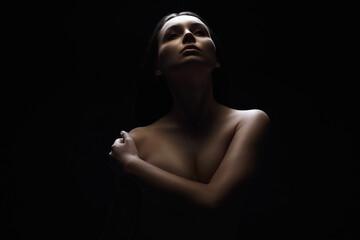 Nude Woman in dark. Female silhouette