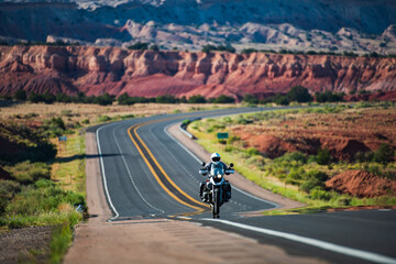 Fotobehang Route 66 Biker driving on motorbike, Route 66, Arizona. Panoramic picture of a scenic road, USA. Natural american landscape with asphalt road to horizon.