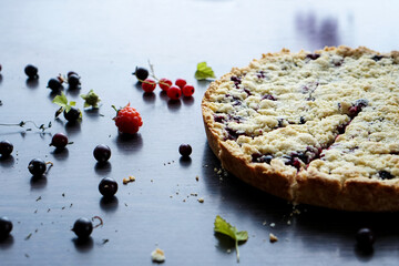 Homemade shortbread berry pie with a slice cut off. Summer photo receipts