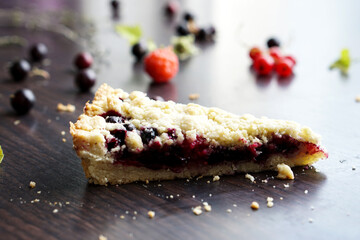 Homemade shortbread slice of berry pie on wooden table. Summer photo receipts