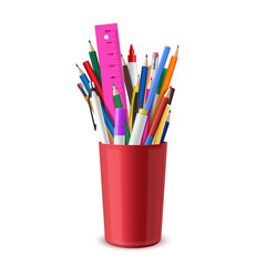 Stationery are in red plastic cup. Pens, pencils, eraser, felt-tips, markers, ruler. School or office supplies.