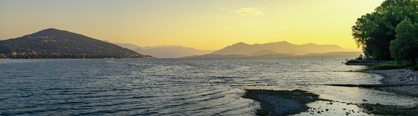 Keuken foto achterwand Zwavel geel Panorama of Lake Maggiore on a morning summer sunrise