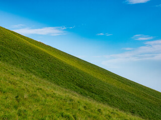 Landscape of a green hill and the sky