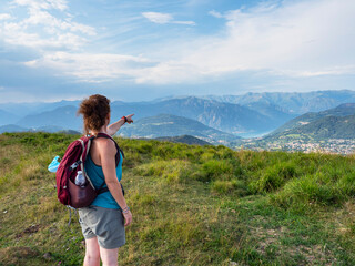 Girls having trekking walk in the alps of Lake Como