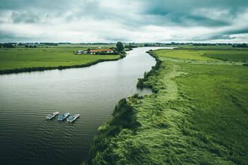 Aerial view of solar panel boats navigating through the farmlands in Nijhuizum, Friesland, The Netherlands.
