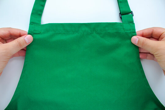 An person holding an apron on a white background.
