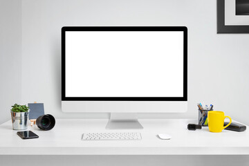Wall Mural - Computer display mockup on office desk with isolated screen for web site design or product presentation