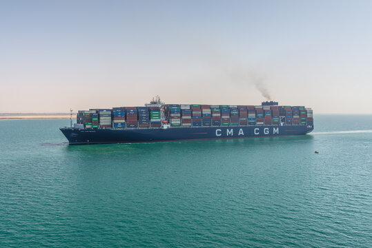 Suez, Egypt - November 14, 2019: Large container vessel ship CMA CGM MEXICO passing Suez Canal in Egypt. The Suez Canal is an artificial sea-level waterway, connecting Mediterranean Sea to Red Sea.