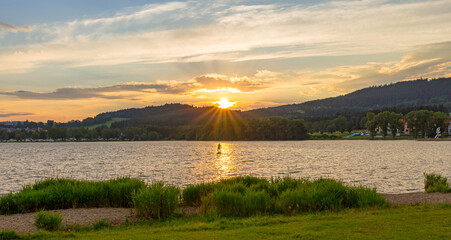 Sunset over Lake Lipno with stand up paddel