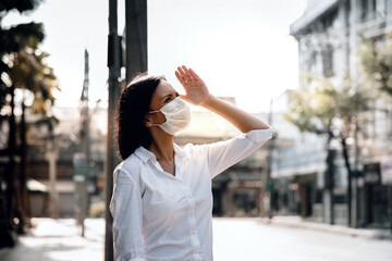 Weather, Pollution and Ecology Issue Concept. Young Woman Wearing Protection Mask against Roadside in the City
