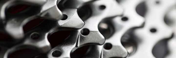 Close-up of bicycle roller chain that transfers power from pedals to drive. Macro shot of metal...