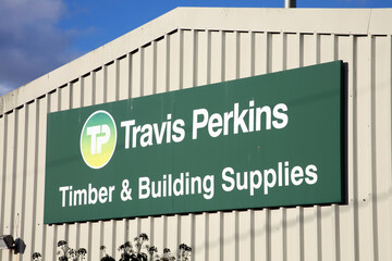 Kidwelly, Wales, UK – January 2, 2017:  Travis Perkins advertising sign outside its building trade supply store stock photo