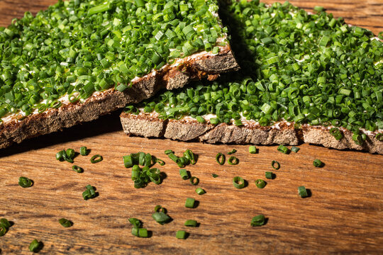 Chive bread with knife on wooden board