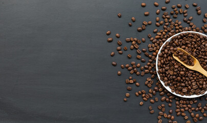 coffee bean on black wooden floor background. top view. space for text