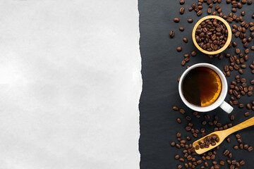 hot coffee, bean and hand grinder on black table background. space for text. top view