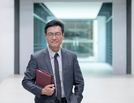 Portrait of a Chinese businessman holding a diary