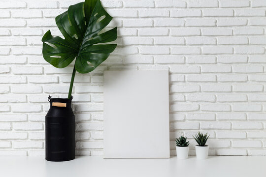 Mock up Empty white canvas frame on desk