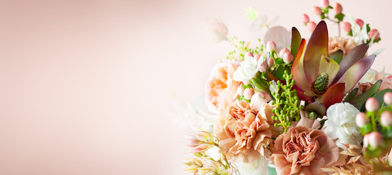 Autumn composition made of beautiful flowers on pastel backdrop. Floristic decoration. Natural floral background.