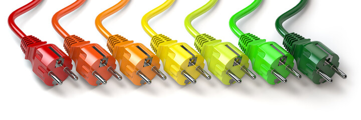 Energy consumption concept. Clolored electric  plugs in colors of energy classification labels.