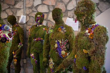 Mannequins representing the 23 victims of the Walmart mass shooting are covered in moss and flowers, at Ascarate Park, in El Paso