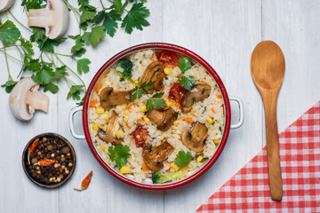 Vegetarian risotto with mushrooms and vegetables on a plate