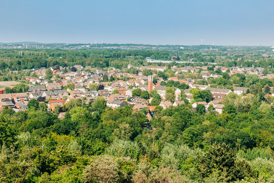 View from Halde Hoheward to residential district with church in Recklinghausen, Germany