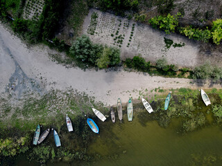 Fishing boats in a small village in Dobrogea, Romania. Aerial view.