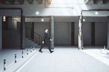 Businessman walking in underground parking interior Fototapete