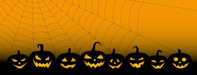 ハロウィーン、ジャック・オー・ランタンとクモの巣の不気味な背景