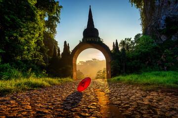 Wall Mural - Gate of Khao Na Nai Luang Dharma Park at sunrise in Surat Thani, Thailand.