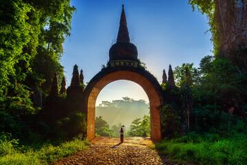 Wall Mural - Woman standing at Khao Na Nai Luang Dharma Park in Surat Thani, Thailand